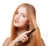 Beautiful girl with comb Royalty Free Stock Photo