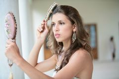 Beautiful girl combs hairs Stock Photo
