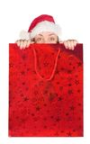 Beautiful girl coming out of christmas bag Royalty Free Stock Images
