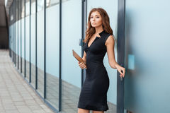 Beautiful girl coming out of the office. Royalty Free Stock Photos
