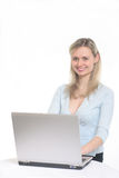 Beautiful girl with computer Royalty Free Stock Photos