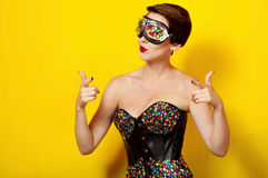 Beautiful girl in a concert suit and sunglasses Stock Photography