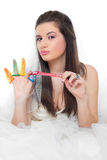 Beautiful girl and condoms Royalty Free Stock Photos