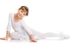 Beautiful girl contortionist in a tracksuit Stock Photo