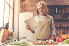 Beautiful girl cooking Royalty Free Stock Images