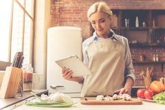 Beautiful girl cooking Stock Photography