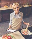 Beautiful girl cooking Stock Photo