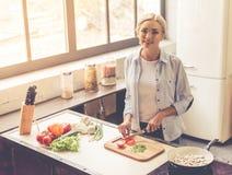 Beautiful girl cooking Royalty Free Stock Photo