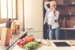 Beautiful girl cooking Royalty Free Stock Image