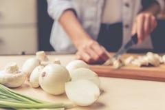 Beautiful girl cooking Stock Photos