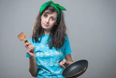 Beautiful girl with a cooking pan Stock Images