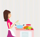 Beautiful girl cooking soup and serving chicken Royalty Free Stock Photos