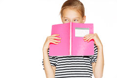 Beautiful girl with copybook. Beautiful little girl in blue dress with copybook. Isolated on white Royalty Free Stock Images