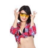 Beautiful girl corrects glasses Stock Photos