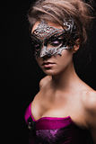 Beautiful girl in corset and mask  with bright makeup . Stock Photography
