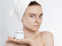 Beautiful girl with cosmetic cream Royalty Free Stock Images