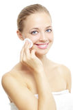 Beautiful girl with cotton pad on white Stock Photo