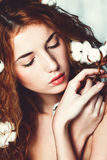 Beautiful girl with cotton plant Royalty Free Stock Photo
