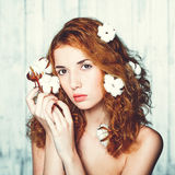 Beautiful girl with cotton plant Royalty Free Stock Photography