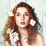 Beautiful girl with cotton plant Stock Photos