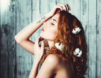 Beautiful girl with cotton plant Royalty Free Stock Image