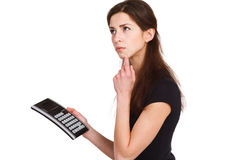 Beautiful girl counts on the calculator Royalty Free Stock Photos