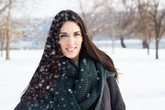 Beautiful girl covered in snowflakes Stock Images