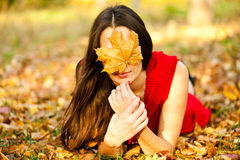 Beautiful girl covers face Royalty Free Stock Photo