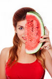 Beautiful girl covers half face a slice of watermelon in studio. Royalty Free Stock Photo