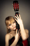 Girl covers naked body guitar Royalty Free Stock Images