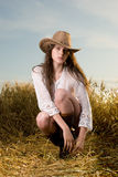 Beautiful girl in cowboy clothes pose Stock Photos