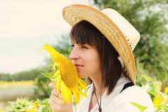 Beautiful Girl in a Cowboy Hat with Sunflowers. Royalty Free Stock Photo