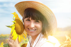 Beautiful Girl in a Cowboy Hat with Sunflowers. Royalty Free Stock Photography