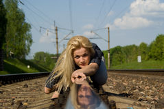 Beautiful girl crawl on rails Stock Photography
