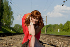 Beautiful girl crawl on rails Stock Image