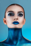 Beautiful girl with creative make-up . Bright colors blue lips.  Conceptual art  the cosmos, the universe Royalty Free Stock Image