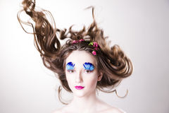 Beautiful girl with creative make-up and hairstyle with flowers Royalty Free Stock Image