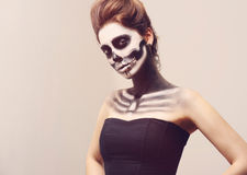 Beautiful girl with creative make-up for the Halloween party. Beautiful woman with make-up skeleton Royalty Free Stock Photos