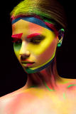 Beautiful girl with creative variegated makeup. beauty face. Photo was made in studio Stock Photo