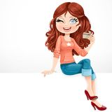 Beautiful girl with a credit card in his hand sitting on banner Royalty Free Stock Images