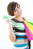 Beautiful girl with credit card and shopping bags. Smiling Royalty Free Stock Images
