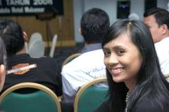 Beautiful girl in the crowd Stock Image