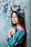 Beautiful girl with a crown of flowers, smiling Stock Photo