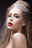 Beautiful girl with a crown in the form of a princess. Beauty face. Royalty Free Stock Image