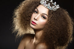 Beautiful girl with a crown in the form of a princess. Royalty Free Stock Photo