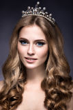 Beautiful girl with a crown in the form of a princess. Royalty Free Stock Photos