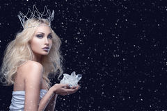Beautiful girl crown holding crystal. Beautiful young woman in crown holding crystal stone. Copy space Stock Photo