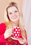 Beautiful girl with cup Stock Photography