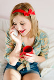 Beautiful girl cup of drink & mobile cell phone. Holding cup of hot drink & mobile cell phone beautiful blonde pinup young woman girl with red lipstick Stock Image