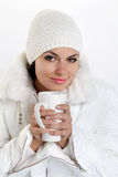 Beautiful girl with cup in hands to keep warm drink Stock Photo